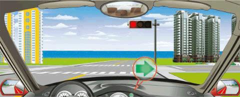 在路口右转弯看到图中信号灯亮时,要在停止线以外停车等待绿灯亮后再向右转弯。
