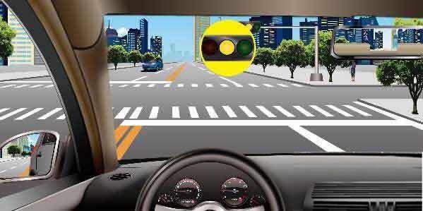 如图所示,驾驶机动车在路口遇黄灯亮时,应停车等待。