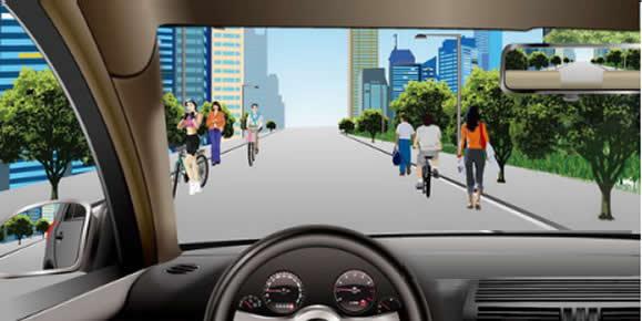 如图所示,驾驶机动车经过这种道路时,应降低车速在道路中间通行。