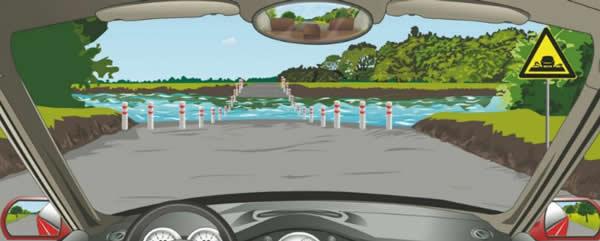 驾驶机动车遇到这种桥时首先怎么办?